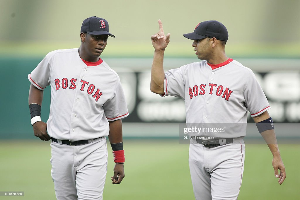 Edgar Renteria (l) and Alex Cora of the Boston Red Sox warm up prior to a game against the Kansas City Royals at Kauffman Stadium in Kansas City, Mo. on August 25, 2005. The Royals won 7-4.