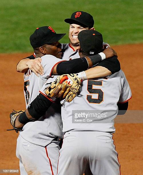 Edgar Renteria Freddy Sanchez and Juan Uribe of the San Francisco Giants celebrate after they defeated the Atlanta Braves 32 during Game Four of the...