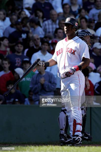 Edgar Renteria of the Boston Red Sox reacts after striking out with bases loaded in the second inning against the New York Yankees during the game at...