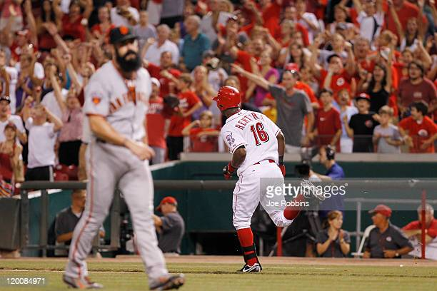 Edgar Renteria of the Cincinnati Reds runs to first base after a single to drive in the gamewinning run in the 13th inning against Brian Wilson of...