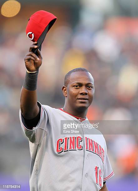 Edgar Renteria of the Cincinnati Reds waves to the crowd after he received his World Series Championship ring that he won while playing for the San...