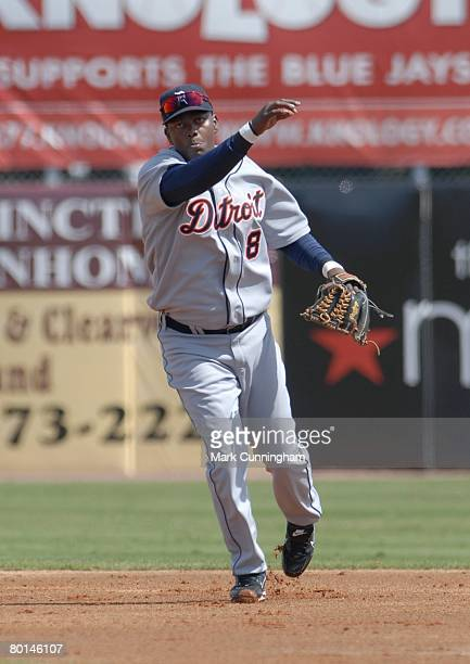 Edgar Renteria of the Detroit Tigers throws during the spring training game against the Toronto Blue Jays at Knology Park in Dunedin Florida on...