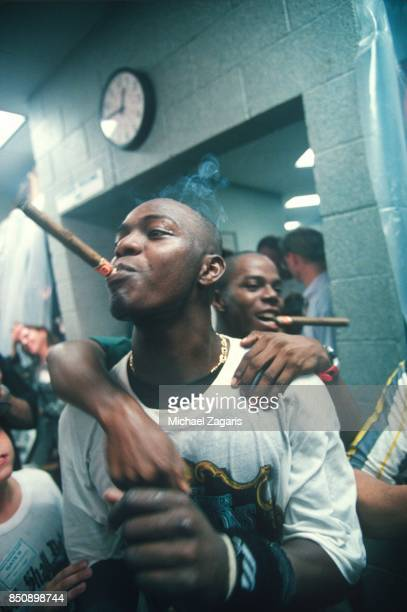 Edgar Renteria of the Florida Marlins celebrates in the clubhouse after the Marlins defeated the Cleveland Indians in Game 7 of the 1997 World Series...