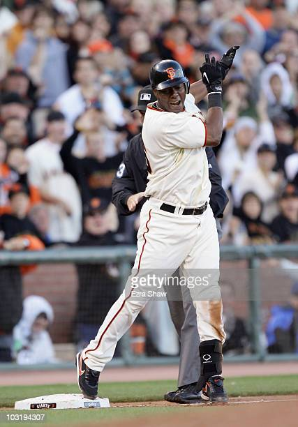 Edgar Renteria of the San Francisco Giants celebrates after he hit a triple that scored two runs in the sixth inning of their game against the Los...