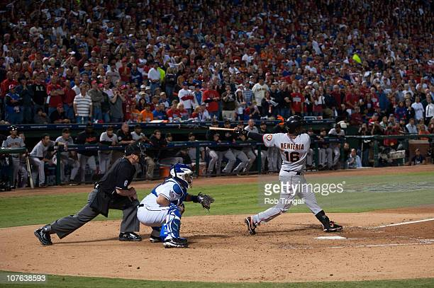 Edgar Renteria of the San Francisco Giants hits a three run home run in the 7th inning off Cliff Lee of the Texas Rangers in Game Five of the 2010...