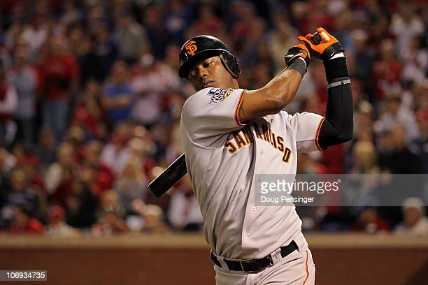 Edgar Renteria of the San Francisco Giants warms up in the on deck circle against the Texas Rangers in Game Five of the 2010 MLB World Series at...