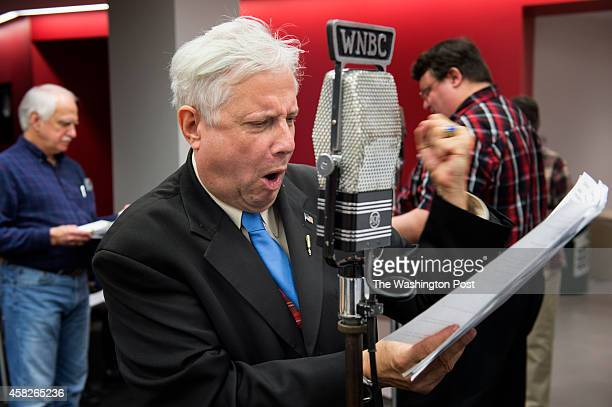 Edgar Russell III center the announcer in the 'Lone Ranger' reads from his script at WAMU 885 FM American University Radio in Washington DC on...