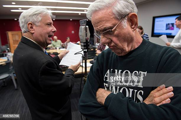Edgar Russell III left works through the script as Jack French writer and director of 'Lone Ranger' listens keenly during rehearsal at WAMU 885 FM...