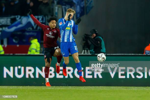 Edgar Salli of 1 FC Nuernberg and Arne Maier of Hertha BSC battle for the ball during the Bundesliga match between 1 FC Nuernberg and Hertha BSC at...