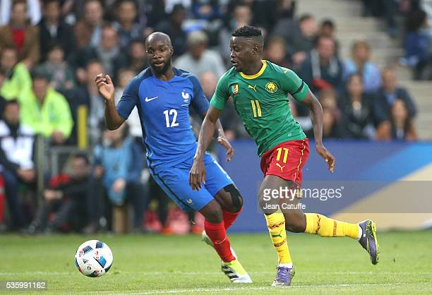 Edgar Salli of Cameroon and Lassana Diarra of France in action during the international friendly match between France and Cameroon at Stade de La...