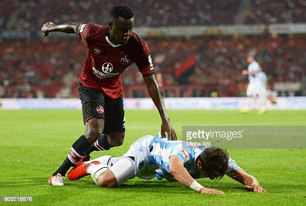Edgar Salli of Nuernberg and Maximilian Wittek of Muenchen compete for the ball during the Second Bundesliga match between 1 FC Nuernberg and TSV...