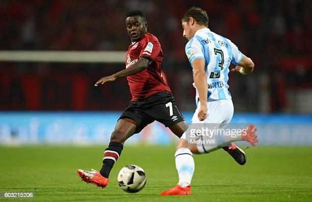 Edgar Salli of Nuernberg challenges Maximilian Wittek of Muenchen during the Second Bundesliga match between 1 FC Nuernberg and TSV 1860 Muenchen at...