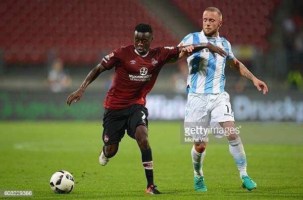 Edgar Salli of Nuernberg is challenged by Daniel Adlung of Muenchen during the Second Bundesliga match between 1 FC Nuernberg and TSV 1860 Muenchen...