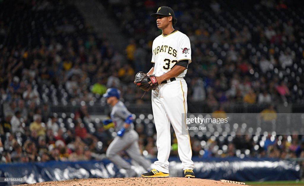 Edgar Santana #37 of the Pittsburgh Pirates reacts as Yasmani Grandal #9 of the Los Angeles Dodgers rounds the bases after hitting a two run home run in the seventh inning during the game at PNC Park on August 22, 2017 in Pittsburgh, Pennsylvania.