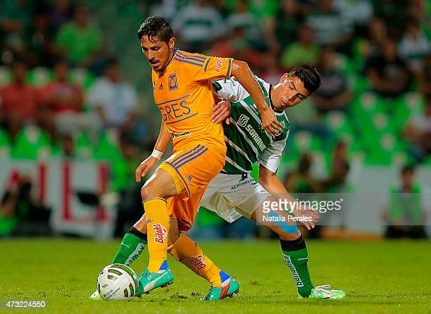Edgar Solis of Tigres fights for the ball with Luis Angel Mendoza of Santos during a quarterfinal first leg match between Santos Laguna and Tigres...