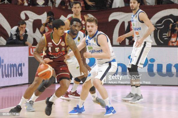 Edgar Sosa and Bruno Cerella of Umana competes with Dario Hunt and Andrea Traini and Michele Vitali of Germani during the LBA Legabasket of Serie A...