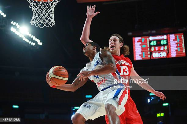 Edgar Sosa of Dominican Republic goes for a layup against Kelly Olynyk of Canada during a second stage match between Dominican Republic and Canada as...