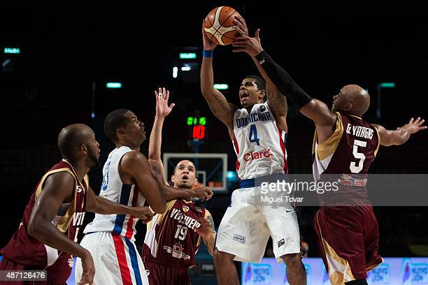 Edgar Sosa of Dominican Republic shoots to the basket during a second stage match between Dominican Republic and Venezuela as part of the 2015 FIBA...