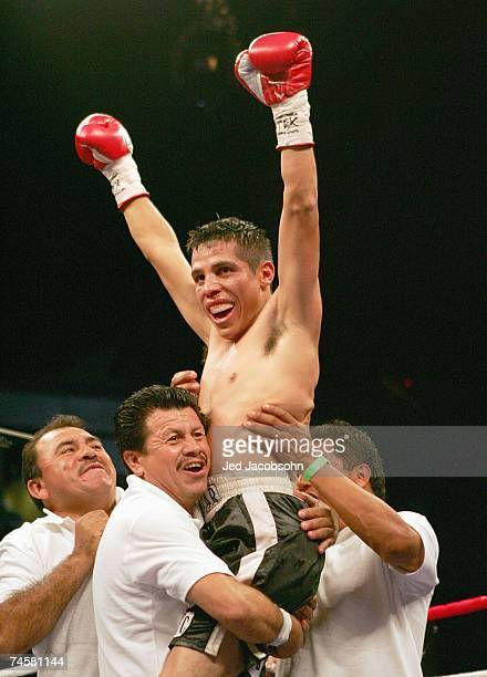 Edgar Sosa of Mexico celebrates after defeating Brian Viloria of the USA after their WBC Mini Flyweight Championship April 14, 2007 at the Alamodome...