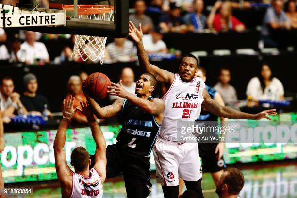 Edgar Sosa of the Breakers goes to the basket against Delvon Johnson of the Hawks during the round 19 NBL match between the New Zealand Breakers and...