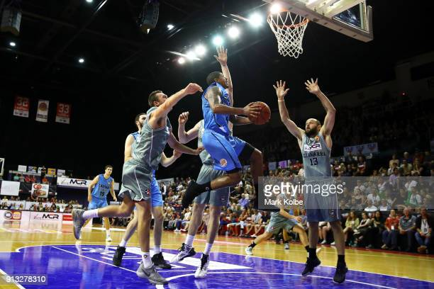 Edgar Sosa of the Breakers lays up a shot under pressure from the Hawks defence during the round 17 NBL match between the Illawarra Hawks and the New...