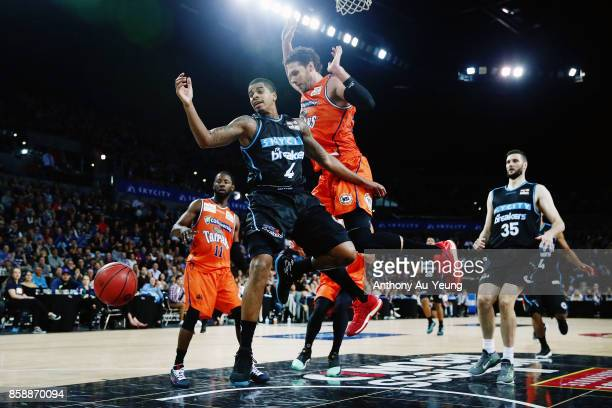 Edgar Sosa of the Breakers loses the ball as he goes up against Alex Loughton of the Taipans during the round one NBL match between the New Zealand...