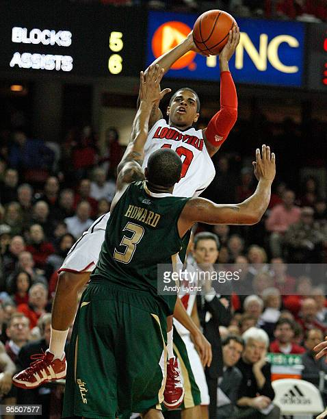 Edgar Sosa of the Louisville Cardinals shoots the ball against Chris Howard of the South Florida Bulls during the Big East Conference game at Freedom...
