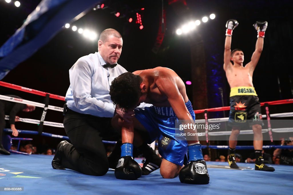 Edgar Valerio celebrates his win as Martin Cardona struggles to his feet in the second round of their Featherweight fight at Belasco Theatre on October 6, 2017 in Los Angeles, California.