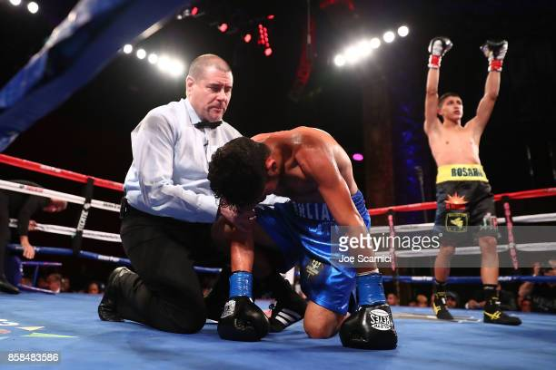 Edgar Valerio celebrates his win as Martin Cardona struggles to his feet in the second round of their Featherweight fight at Belasco Theatre on...