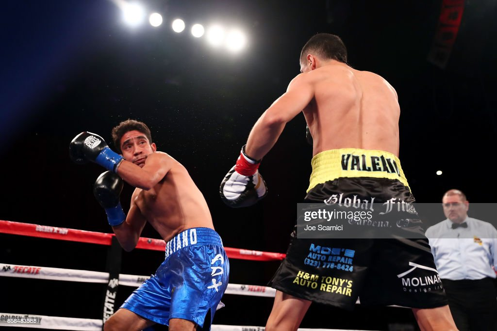 Edgar Valerio throws a punch at Martin Cardona in the first round of their Featherweight fight at Belasco Theatre on October 6, 2017 in Los Angeles, California.