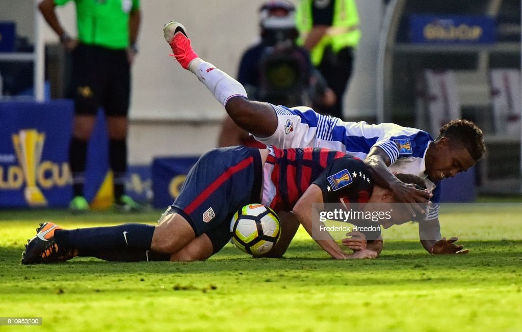 Edgar Yoel Barcenas #8 of Panama falls on Matt Besler #5 of USA during the second half of a CONCACAF Gold Cup Soccer match at Nissan Stadium on July 8, 2017 in Nashville, Tennessee.