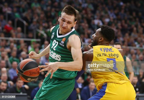 Edgaras Ulanovas #92 of Zalgiris Kaunas competes with Deandre Kane #7 of Maccabi Fox Tel Aviv in action during the 2017/2018 Turkish Airlines...