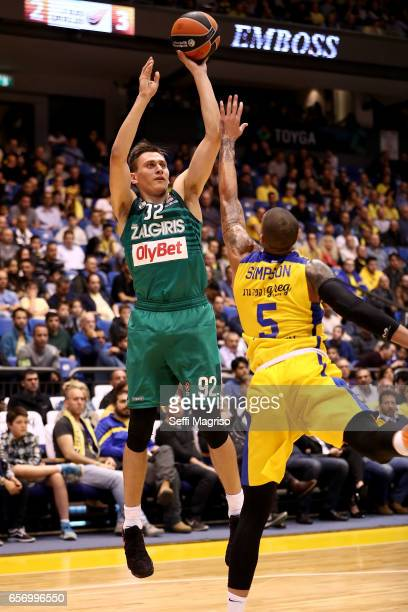 Edgaras Ulanovas #92 of Zalgiris Kaunas competes with Diamon Simpson #5 of Maccabi Fox Tel Aviv in action during the 2016/2017 Turkish Airlines...