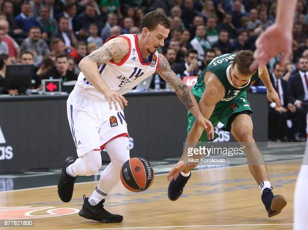 Edgaras Ulanovas #92 of Zalgiris Kaunas competes with Josh Adams #14 of Anadolu Efes Istanbul in action during the 2017/2018 Turkish Airlines...