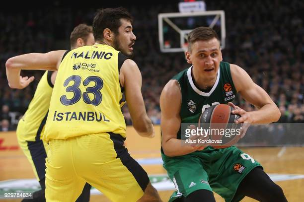 Edgaras Ulanovas #92 of Zalgiris Kaunas competes with Nikola Kalinic #33 of Fenerbahce Dogus Istanbul in action during the 2017/2018 Turkish Airlines...