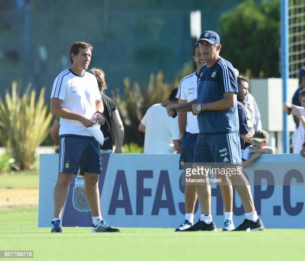 Edgardo Bauza coach of Argentina talks with Argentina U20 coach Claudio Ubeda during a training session at Argentine Football Association 'Julio...
