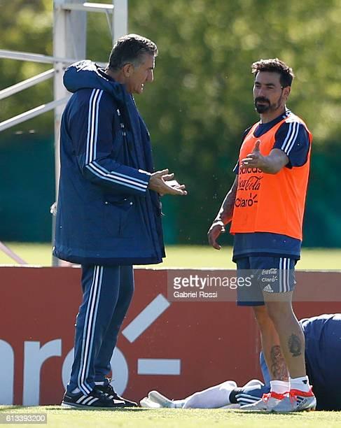 Edgardo Bauza coach of Argentina talks with Ezequiel Lavezzi during a training session at Argentine Football Association 'Julio Humberto Grondona'...
