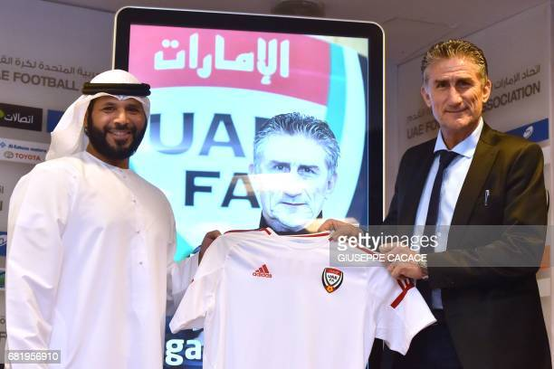 Edgardo Bauza the new Argentinian coach of UAE's national team poses for a photo with the President of UAE Football Association Marwan bin Ghalaita...