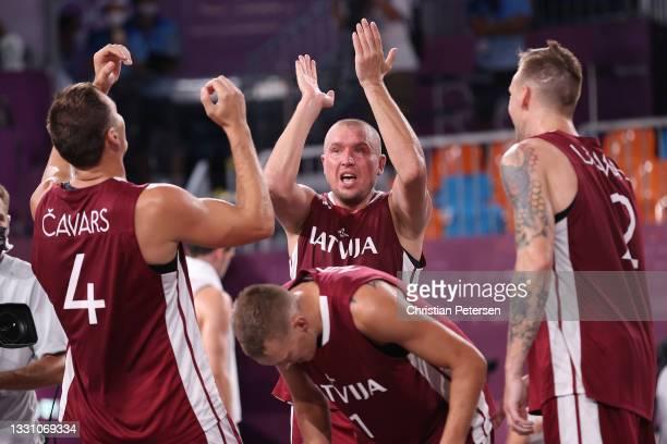Edgars Krumins of Team Latvia celebrates victory with Agnis Cavars, Nauris Miezis and Karlis Lasmanis of Team Latvia in the 3x3 Basketball...