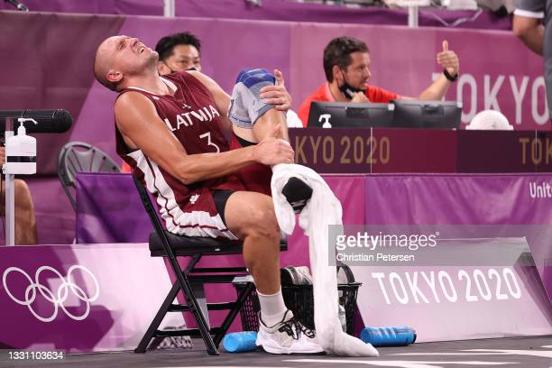 Edgars Krumins of Team Latvia is seen after a collision in the 3x3 Basketball competition on day five of the Tokyo 2020 Olympic Games at Aomi Urban...