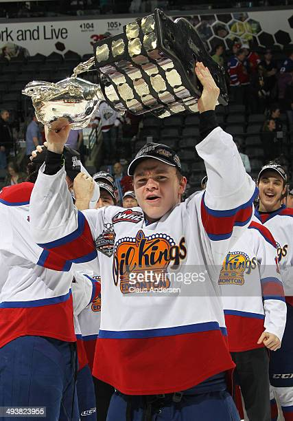 Edgars Kulda of the Edmonton Oil Kings hoists the MasterCard Memorial Cup after defeating the Guelph Storm in the final of the 2014 MasterCard...