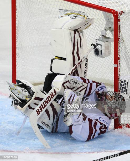 Edgars Masalskis goaltender of Latvia lies on the ice during the IIHF World Championship group H match between Russia and Latvia at Hartwall Areena...