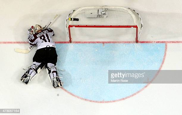 Edgars Masalskis goaltender of Latvia lies on the ice during the IIHF World Championship group A match between Latvia and France at o2 Arena on May...