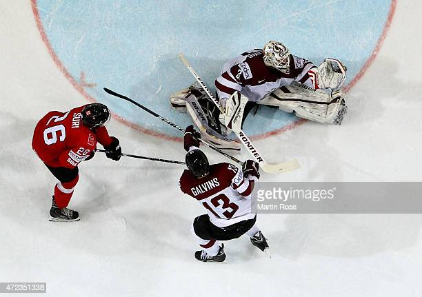 Edgars Masalskis goaltender of Latvia makes a glove save during the IIHF World Championship group A match between Switzerland and Latvia at o2 Arena...