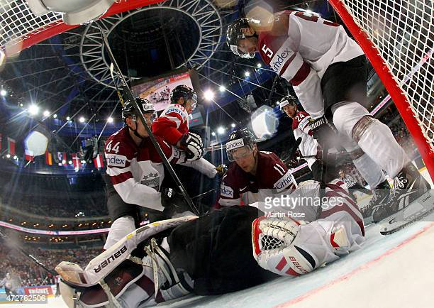 Edgars Masalskis goaltender of Latvia tends net against Austria during the IIHF World Championship group A match between Austria and Latvia at o2...
