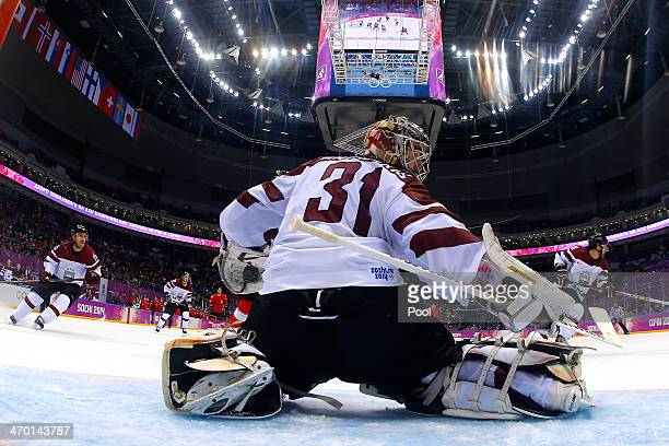 Edgars Masalskis of Latvia tends goal against Switzerland during the Men's Ice Hockey Qualification Playoff game on day eleven of the Sochi 2014...