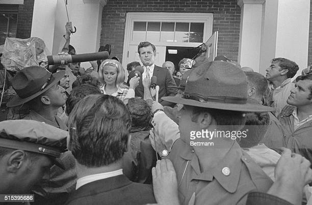 Lady with a camera gets closeup view as Sen Edward M Kennedy escorts wife Joan through crowd of newsmen to Dukes County Court House for start of...