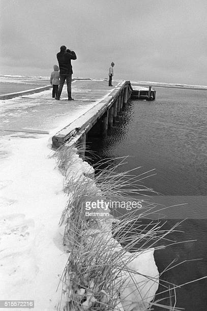 Several hardy souls braved the cold at this summer resort 1/4 to view bridge on Chappaquiddick Island where Mary Jo Kopechne was killed last 7/18 The...