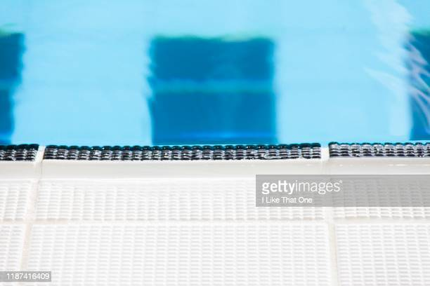 edge of a swimming pool - atomic imagery stock pictures, royalty-free photos & images