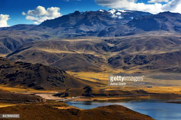 Edge of high-altitude Laguna Lagunillas in Puno District, Peru, a wildlife area home to flamingos and other birds
